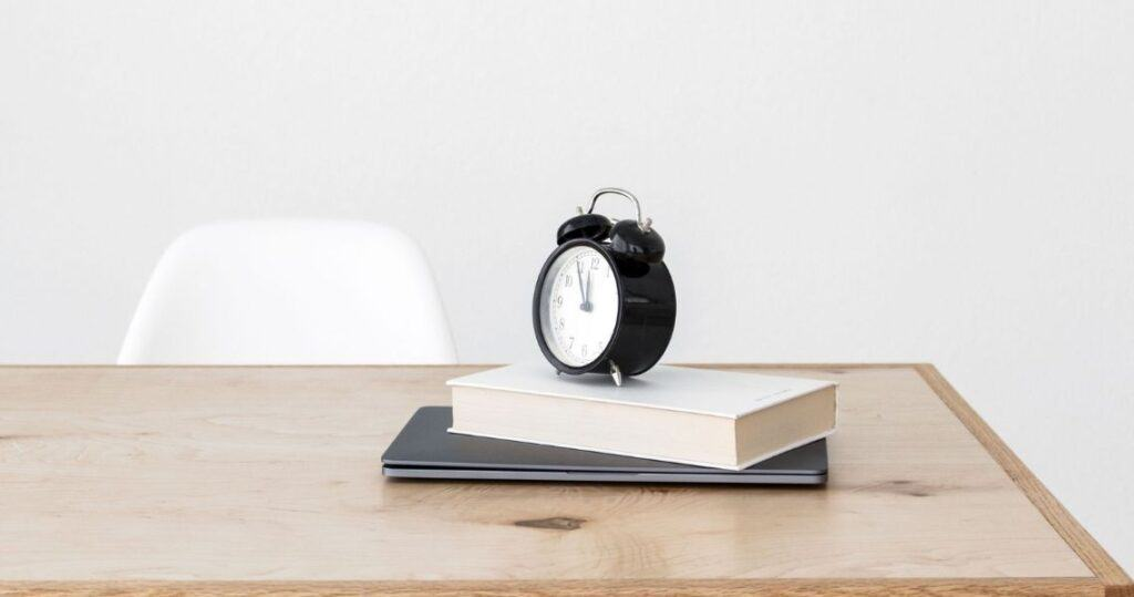 Black clock on the table | Time Management 101