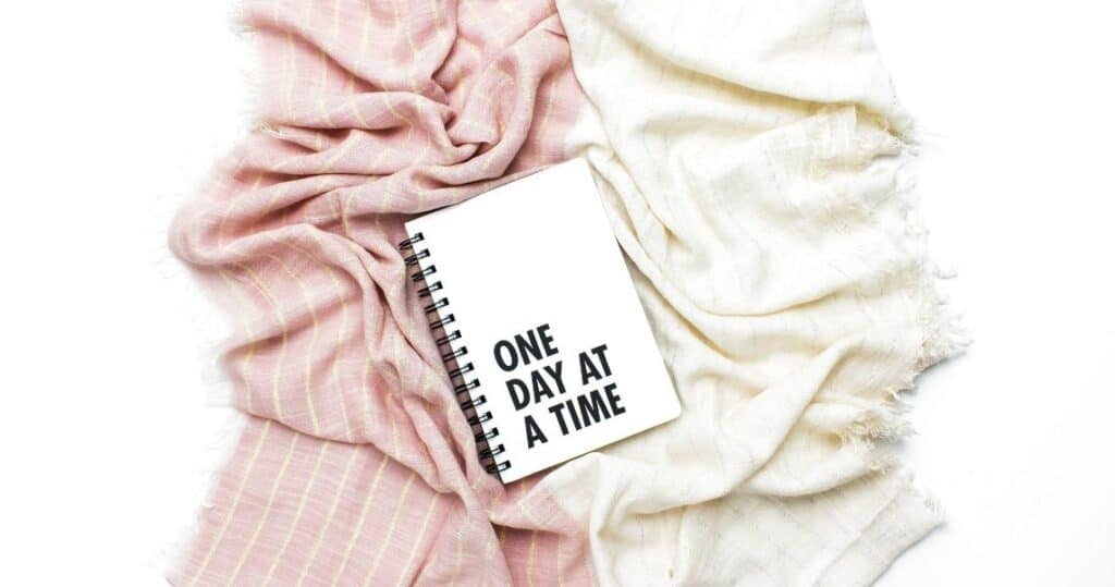 Notebook that says One Day At A Time | Time management 101